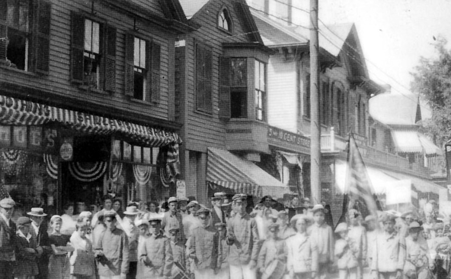 Market St. early photo of a parade