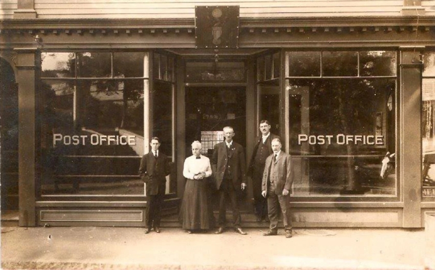 Central St. Post Office by George Dexter. Postmaster Luther Wait is the tall man standing on the right.