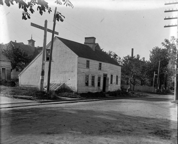 Unknown building and trolley tracks by George Dexter