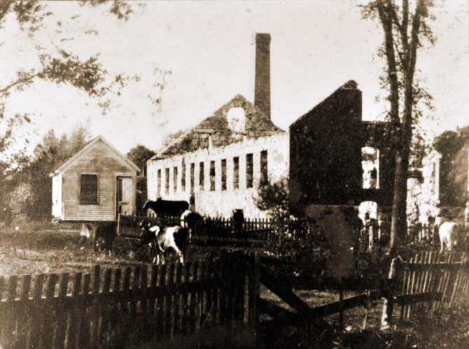 "The Willowdale Mill: In February of 1824, permission was given to build a dam here in order to provide water power for a mill, but it was not built until 1829. This dam was said to be about 6' tall in a 1918 report and is still standing today. Foote Brothers Canoe Rentals was established here in 1955 and is still in operation today with second and third generation family members operating the business.The first mill built here was a Sawmill in 1829. In 1834 it was converted into a Textile Mill. It produced hosiery as well as woolen goods and was in operation until a fire in January of 1884 destroyed it. The foundation can still be seen today. A long sluice-way was built here and runs parallel with the river, directing the water flow under the mill. (from ""The Industrial History of the Ipswich River."") Photo by Edward L. Darling, from the collection of William J. Barton."