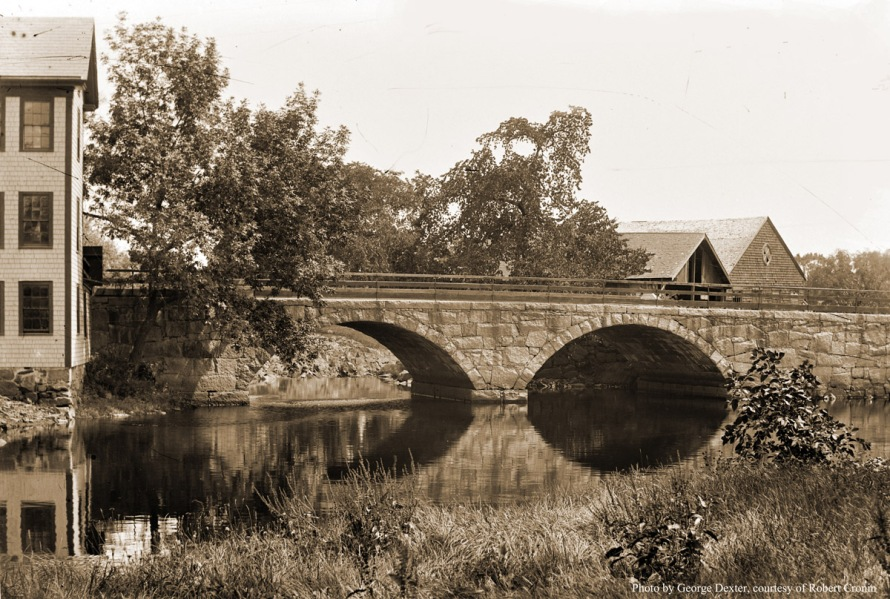"The County St. Bridge. William J. Barton wrote, ""In December, 1860, Ira Worcester and others of Ipswich, Hamilton, Wenham and Essex addressed a petition to the County commissioners. At that time, Cross Street as it was called, terminated at Green Street (the present day County Street) and all travel towards Hamilton passed  over Town Hill , down the hill and over the Choate Bridge. The petitioners characterized this route as very circuitous and hilly, and inconvenient. The County Commissioners laid out the new road on March 5, 1861. The town voted on March 11 to build the bridge. The County Street stone arch bridge was built in 1861 by the town at a cost of $7896.75. Thomas J. Roberts, an Ipswich citizen who was a master builder on the Boston City Hall, the Thatcher Island Lighthouse etc. was the superintendent."" Photo by George Dexter."