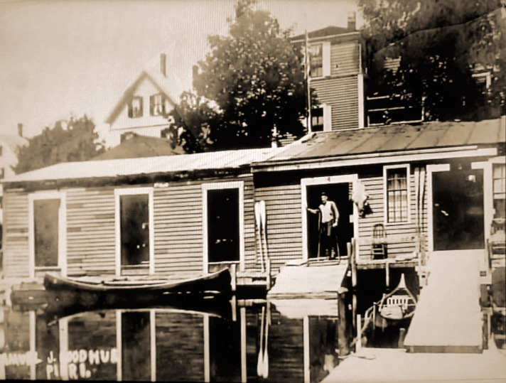 """Justabove the dam was Goodhue's Boathouse, at the end of PeatfieldSt.It was in business as early as 1891, and rented boats for recreation as well as offering accommodations. The location is a public canoe launch today. (from """"The Industrial History of the Ipswich River"""") Photo courtesy of Bill George"""