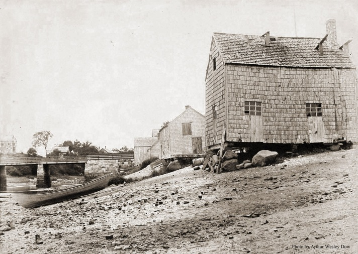 Clam shacks, with the earlier wooden Green St. Bridge in the background. Photo by Arthur Wesley Dow.