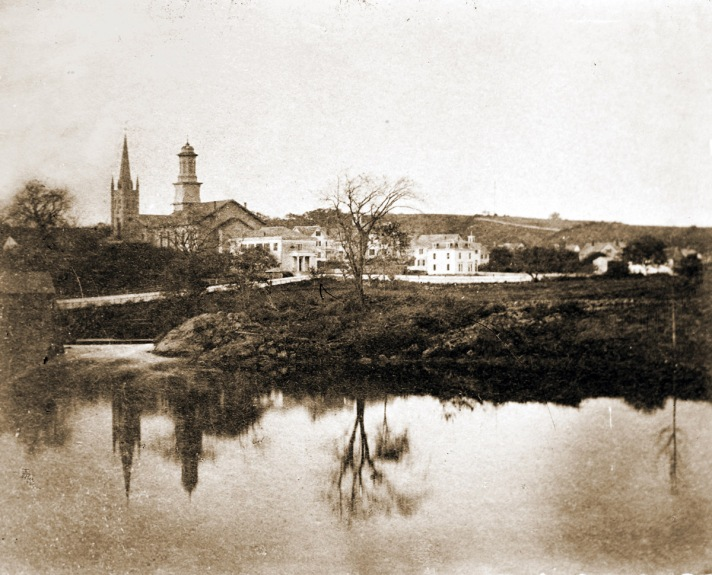County St. and the two steeples circa 1860, before the Ascension Church was built. The identify the building directly behind the Methodist Church is unknown. The former Episcopal parsonage is at that location now.