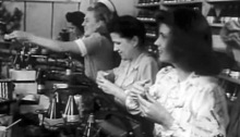 Women working in a proximity fuze plant (site unknown).