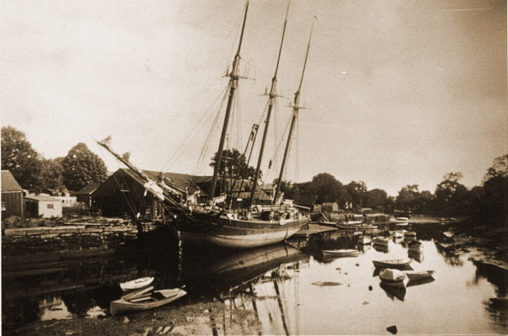 """William J. Barton wrote, """"The wharf where the vessel was tied up was known as Glover's Wharf. The vessel was delivering a shipload of coal to John S. Glover. The vessel carried about 350 tons of coal. Wood and oal were burned for fuel, and coal was sold for $6.50 / ton. No kerosene was used for fuel at this time, except for in lamps for light. Mr. Glover dealt in coal, lime and cement. He lived at 66 East Street on the corner of Cogswell Street. The coal was delivered by William P. Ross in a dump wagon, and drawn by a pair of horses. Ross lived at 53 East Street. Later on the business was taken over by Charles L. Lovell."""""""