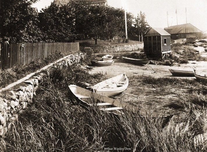 Clam boats on Water St. with Glover's Wharf in the background. Photo by Arthur Wesley Dow.