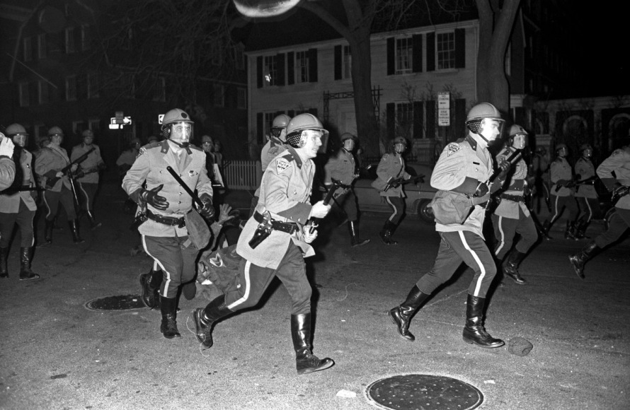 Troopers assaulted demonstrators at a Cambridge anti-war rally.