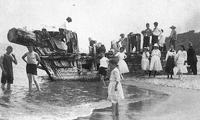 The Appleton family on an outing at Steep Hill Beach, exploring the wreck of the Ada K. Damon