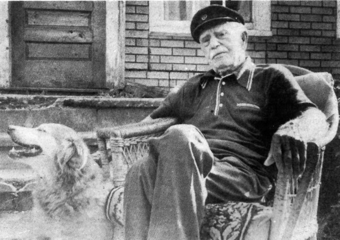 Former mill foreman Steve Georgakopoulos, 95 and his dog Mouyatsta, outside of their High Street home, July 1984