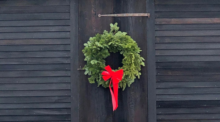 Wreath on a door in Ipswich MA. Photo by Peter Bubriski