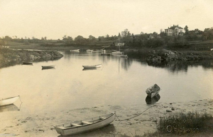 The John W. Newman house is in the upper right in this photo taken from the Town Wharf around 1900.