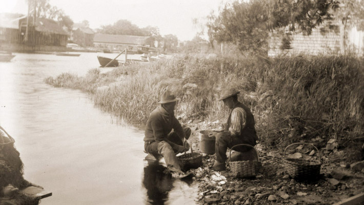 Shucking clams on the Ipswich River circa 1900