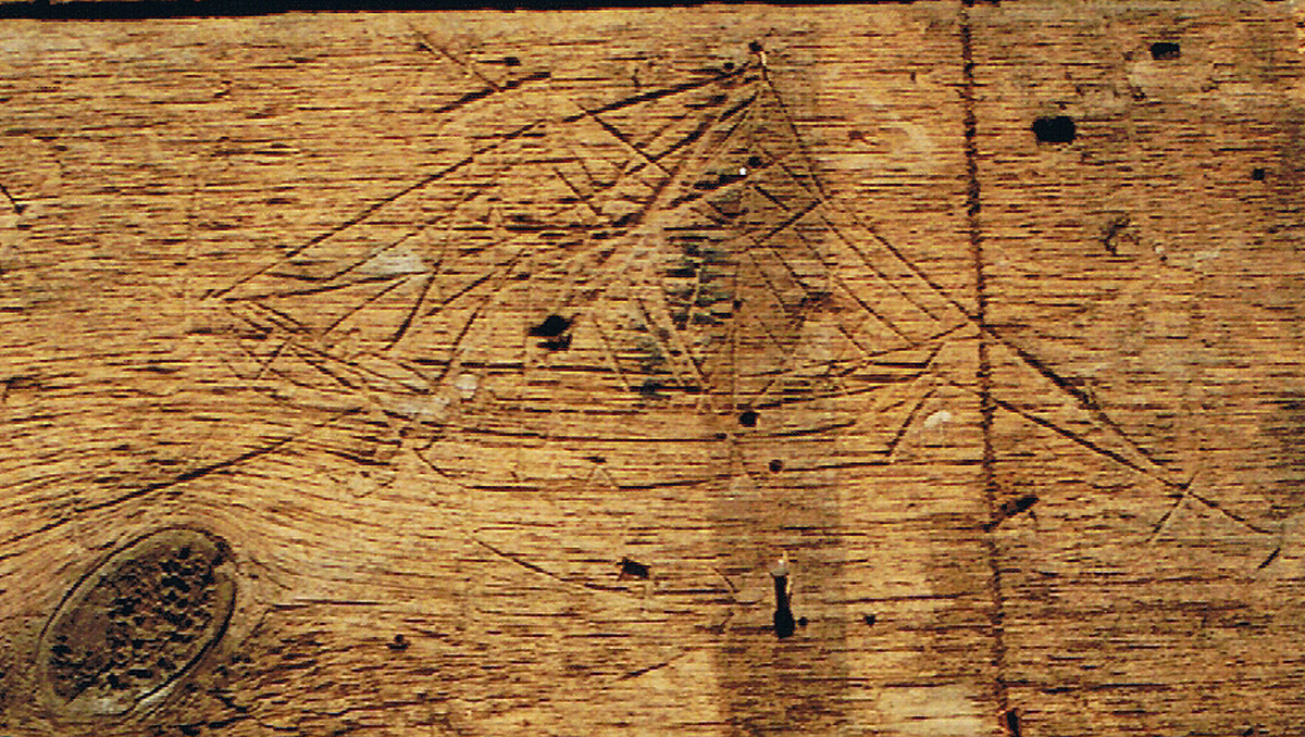Carving of a ship on wall sheathing