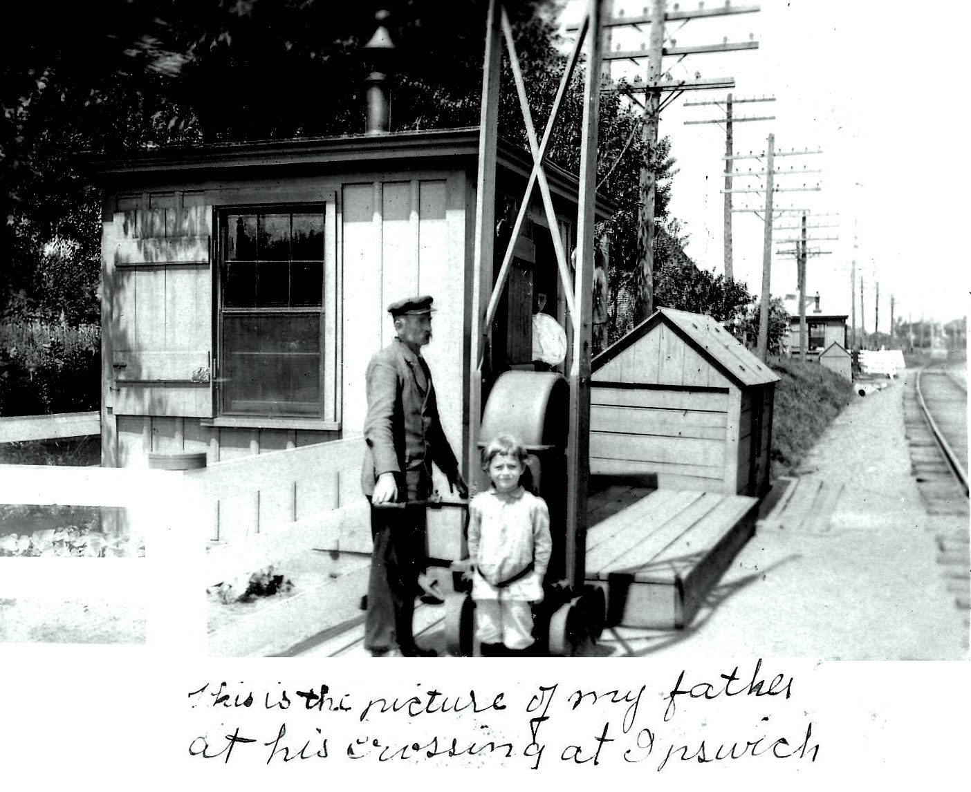 Photo of railroad crossing with father and daughter