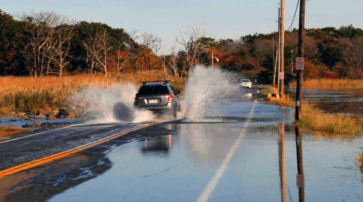 Argilla Road at Crane Beach flooded by high tides