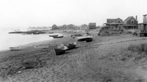 Boats and houses in an early 20th Century photo of Plum Island, near Newburyport MA