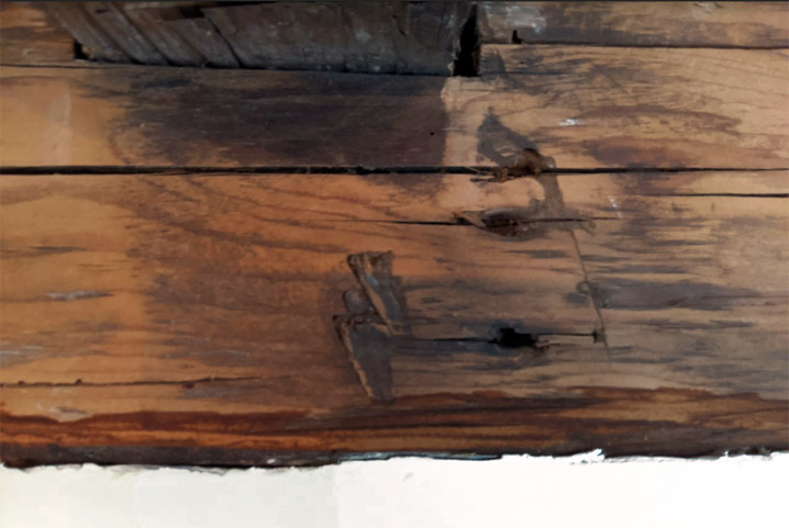 "Unusual ""lightning"" shaped marks are near several beam joints in #8 N. Main."