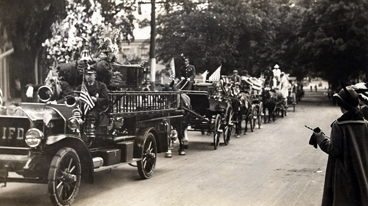 Early 20th century parade in Ipswich with fire trucks