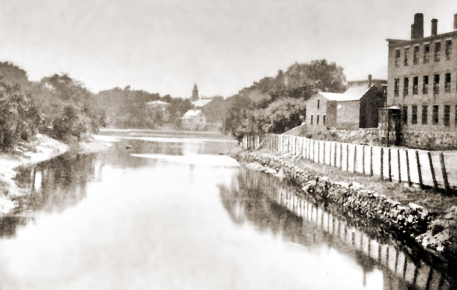 The jail is on the right in this photo looking upstream from the Green St. bridge.